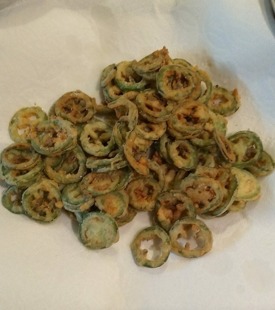 fried jalapenos draining on paper towells